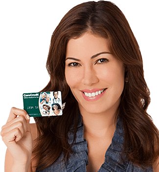 woman holding carecredit card